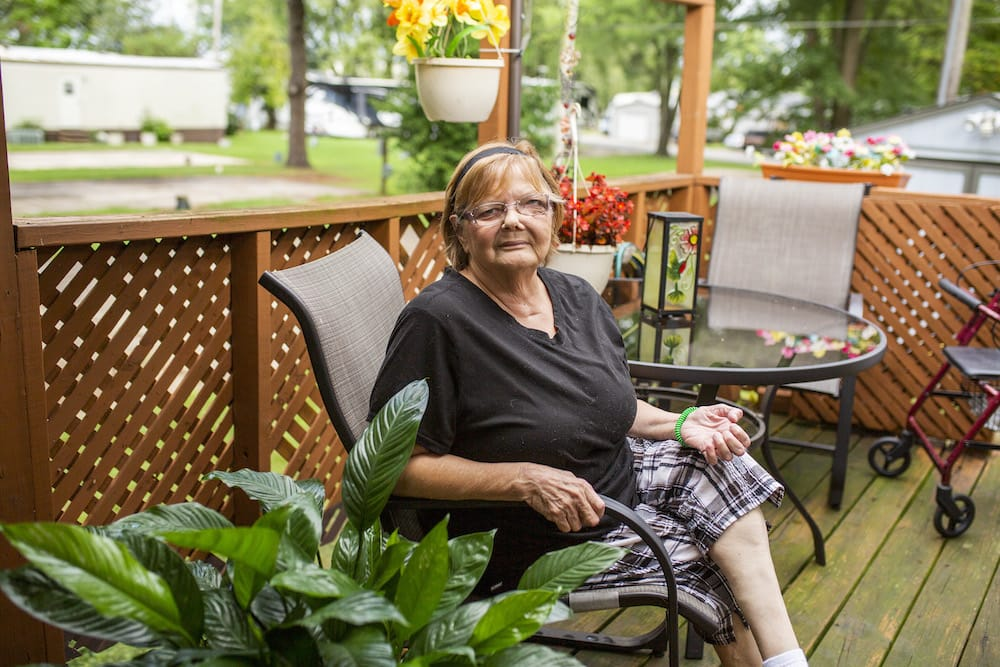 A woman sitting on her outdoor patio